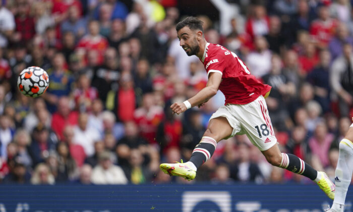 Manchester United's Bruno Fernandes scores his third goal during the English Premier League soccer match between Manchester United and Leeds United at Old Trafford in Manchester, England, on Aug. 14, 2021. (Jon Super/AP Photo)