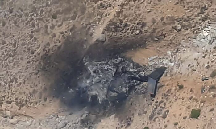 This screenshot shows a general view of the wreckage of a Russian Bombadier Be-200 aircraft at Kahramanmaras, southern Turkey, on Aug. 14, 2021. (Demiroren News Agency (DHA)/AFP via Getty Images)