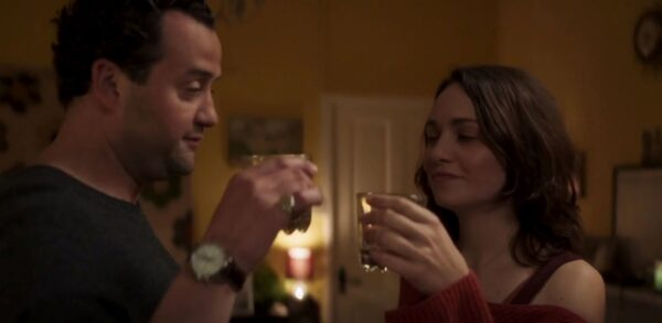 man and woman having a toast