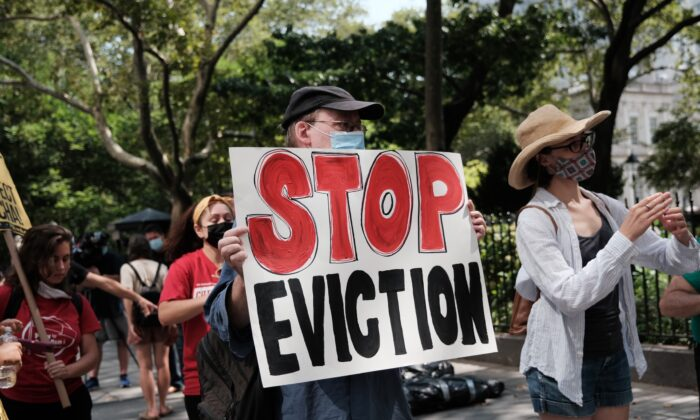 Activists hold a protest against evictions near City Hall in New York City, on Aug. 11, 2021. (Spencer Platt/Getty Images)