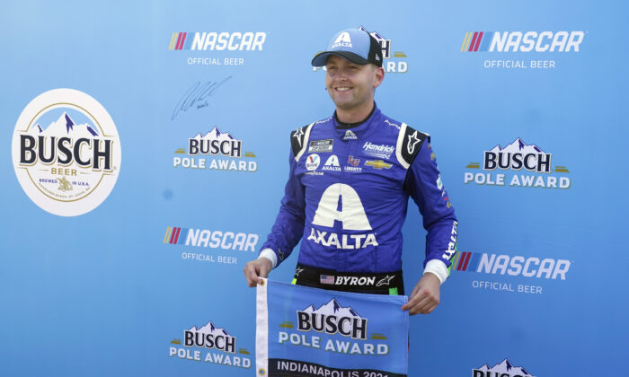 William Byron poses after winning the pole for the NASCAR Series auto race at Indianapolis Motor Speedway, in Indianapolis, on Aug. 15, 2021. (Darron Cummings/AP Photo)