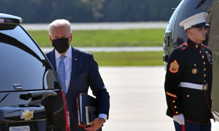 President Joe Biden steps off Marine One upon arrival at Delaware Air National Guard Base in New Castle, Del., on Aug. 12, 2021. (Nicholas Kamm/AFP via Getty Images)