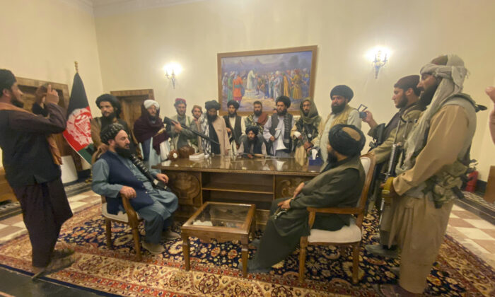 The Taliban take control of the Afghan presidential palace after the Afghan President Ashraf Ghani fled the country, in Kabul, Afghanistan, on Aug. 15, 2021. (Zabi Karimi/AP Photo)