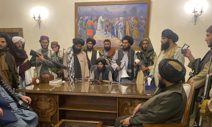 Taliban terrorists take control of Afghan's presidential palace after Afghan President Ashraf Ghani fled the country, in Kabul, Afghanistan, on Aug. 15, 2021. (Zabi Karimi/AP Photo)
