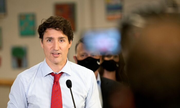 Canada's Prime Minister Justin Trudeau talks during a news conference at the daycare inside Carrefour de l'Isle-Saint-Jean school in Charlottetown, Prince Edward Island, Canada, on July 27, 2021. (John Morris/Reuters)