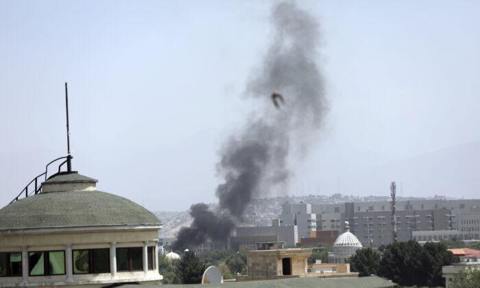 Smoke rises next to the U.S. Embassy in Kabul, Afghanistan, on Aug. 15, 2021. (Rahmat Gul/AP Photo)