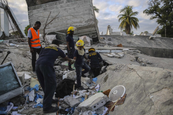 Firefighters search for survivors i