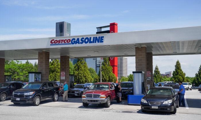 Consumers pump gas at a Costco gasoline station in Atlanta, Ga., on May 11, 2021. (Elijah Nouvelage/AFP via Getty Images)