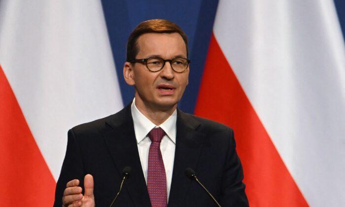 Polish Prime Minister Mateusz Morawiecki addresses a press conference in Budapest on April 1, 2021. (Attila Kisbenedek/AFP via Getty Images)