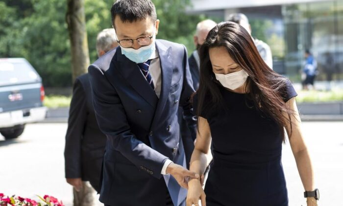 Meng Wanzhou, chief financial officer of Huawei, leaves for a lunch break during her extradition hearing at B.C. Supreme Court, in Vancouver, B.C., on Aug. 13, 2021. (The Canadian Press/Jimmy Jeong)