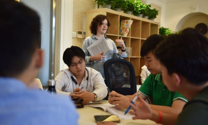 College counsellor speaks with students during a class at Elite Scholars China (ESC), a boutique college consultancy where students can receive application guidance, mentoring, and advice on the best courses for their interests and skills, in Beijing, China on July 19, 2019. (GREG BAKER/AFP via Getty Images)