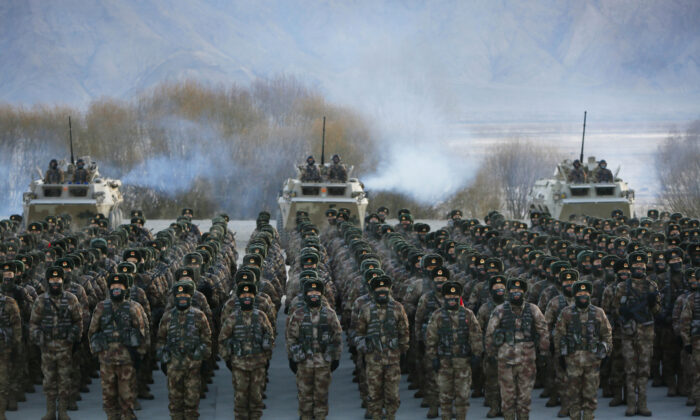 This photo taken on January 4, 2021 shows Chinese People's Liberation Army (PLA) soldiers assembling during military training at Pamir Mountains in Kashgar, northwestern China's Xinjiang region. (STR/AFP via Getty Images)