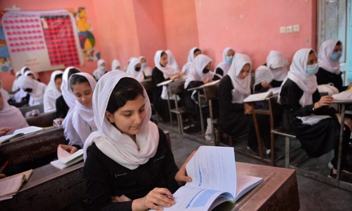Girls attend their class at a school in Herat on May 9, 2021. (Hoshang Hashimi/AFP via Getty Images)