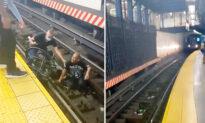 Video Shows Man in Wheelchair Fallen on Subway Train Tracks, Good Samaritan Saving Him