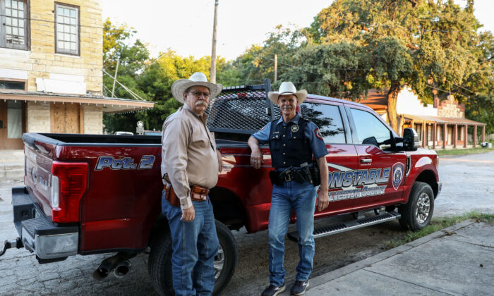 Kinney County Sheriff Brad Coe (L) and Galveston Constable Jimmy Fullen outside the sheriff's office in Brackettville, Texas, on Aug. 16, 2021. (Charlotte Cuthbertson/The Epoch Times)