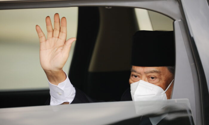 Malaysian Prime Minister Muhyiddin Yassin arrives at the National Palace for a meeting with the king in Kuala Lumpur, Malaysia, on Aug. 16, 2021. (Lim Huey Teng/Reuters)