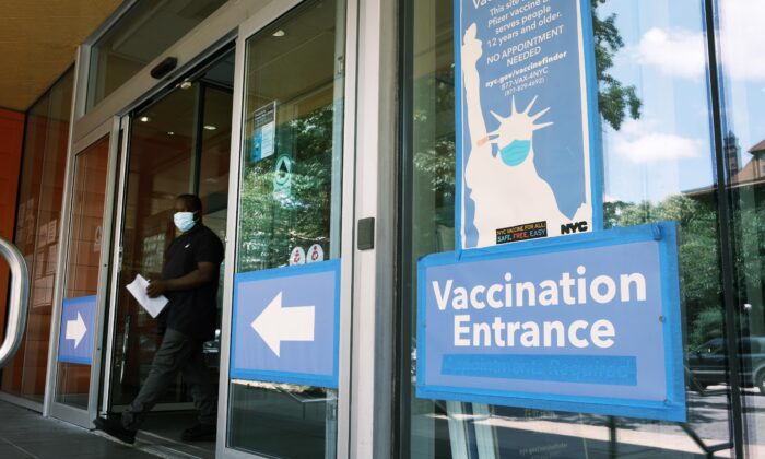 A city-operated mobile pharmacy advertises the COVID-19 vaccine in a Brooklyn neighborhood in New York City on July 30, 2021. (Spencer Platt/Getty Images)