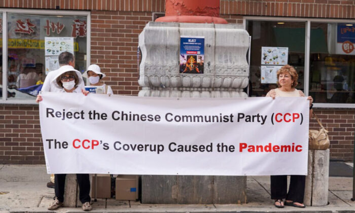 People rallied in Philadelphia Chinatown on Aug. 8, with a theme to expose communism's atrocities and raise awareness of the dangers of socialism and communism. (William Huang/The Epoch Times)