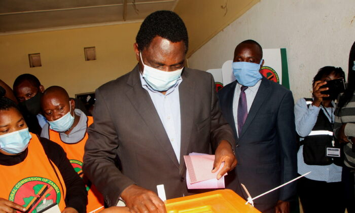 Opposition UPND party's presidential candidate Hakainde Hichilema casts his ballot in Lusaka, Zambia, on Aug. 12, 2021. (Jean Ndaisenga/Reuters)