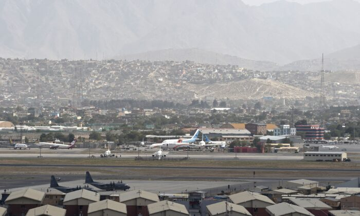 Aircrafts standing on the tarmac of the airport in Kabul on Aug. 14, 2021. (WAKIL KOHSAR/AFP via Getty Images)