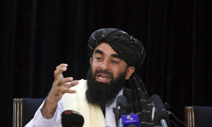 Taliban spokesman Zabihullah Mujahid speaks at his first news conference, in Kabul, Afghanistan on Aug. 17, 2021. (Rahmat Gul/AP Photo)