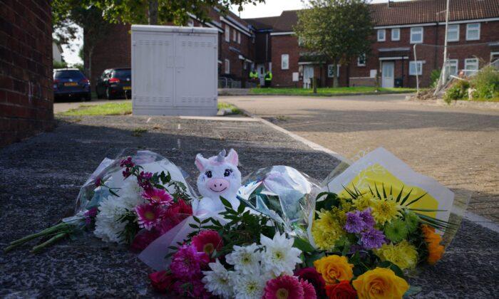 Floral tributes left in Biddick Drive, Keysham, where five people were killed by gunman Jake Davison, in Plymouth, UK, on Aug. 16, 2021. (Ben Birchall/PA)