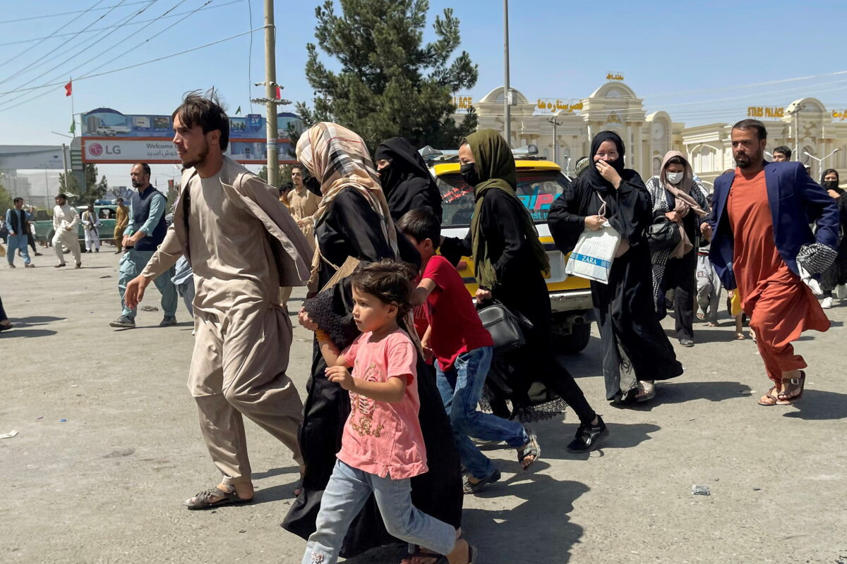 FILE PHOTO: People try to get into Hamid Karzai International Airport in Kabul