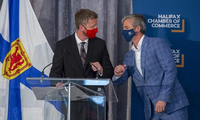 Premier Iain Rankin, left, and Progressive Conservative leader Tim Houston bump elbows at a Halifax Chamber of Commerce pre-election event in Halifax on Aug. 4, 2021. (The Canadian Press/Andrew Vaughan)