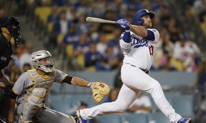 Los Angeles Dodgers' Max Muncy follows through on his solo home run during the eighth inning of a baseball game against the Pittsburgh Pirates in Los Angeles on Aug. 16, 2021. (AP Photo/Marcio Jose Sanchez)