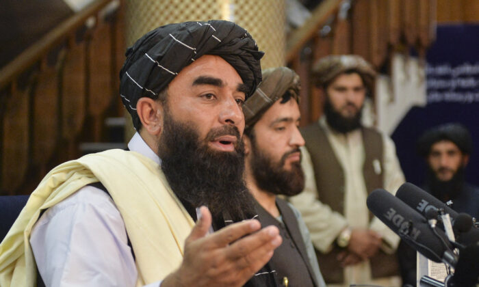 Taliban spokesperson Zabihullah Mujahid (L) gestures as he speaks during the first press conference in Kabul on Aug. 17, 2021 following the Taliban stunning takeover of Afghanistan. (Hoshang Hashimi /AFP via Getty Images)