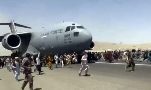 Afghan Woman in Limbo at Kabul Airport After Taliban Sweep