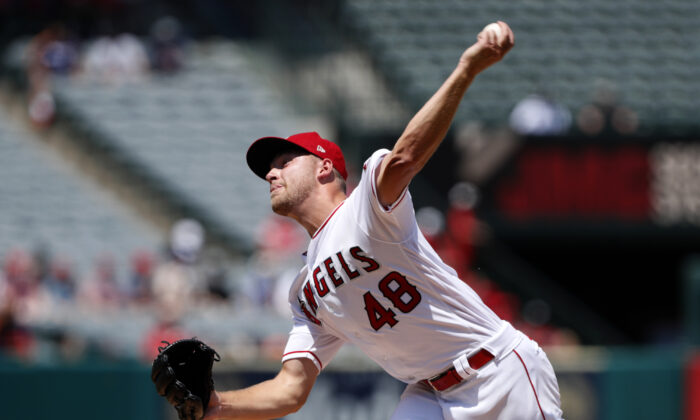Los Angeles Angels starting pitcher Reid Detmers throws to a Houston Astros batter during the second inning of a baseball game in Anaheim, Calif., on Aug. 15, 2021. (AP Photo/Alex Gallardo)