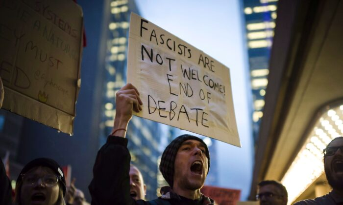 Protesters demonstrate outside a Munk Debate featuring political strategist and filmmaker Steve Bannon and political commentator and author David Frum in Toronto on Nov. 2, 2018. (The Canadian Press/Christopher Katsarov)