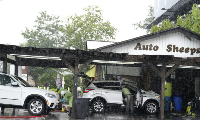 People wash and dry cars as it stores near Atlanta, while hurricane Fred makes its way through north and central Georgia on Aug. 17, 2021. (Brynn Anderson/AP Photo)