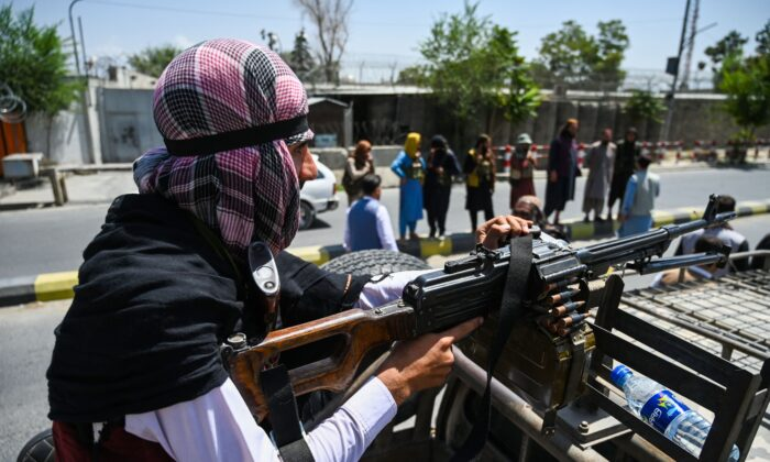 A Taliban fighter mans a machine gun atop a vehicle while patroling a street in Kabul, Afghanistan, on Aug. 16, 2021. (Wakil Kohsar/AFP via Getty Images)