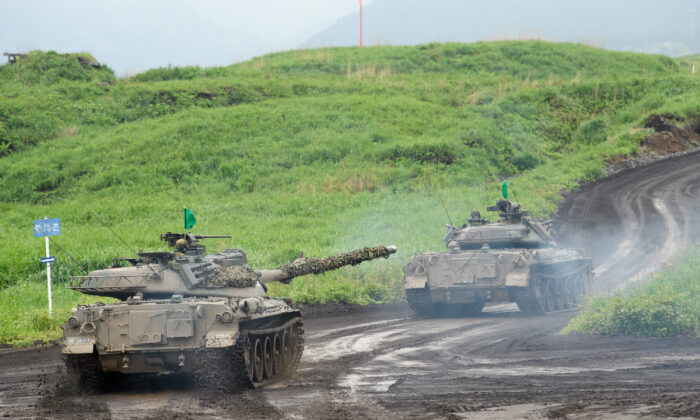 Japan's Ground Self-Defense Forces (JGSDF) Type-74 tanks move during a live fire exercise at JGSDF's training grounds in the East Fuji Maneuver Area on May 22, 2021 in Gotemba, Shizuoka, Japan.  (Akio Kon - Pool/Getty Images)