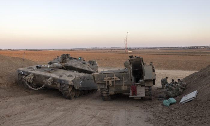 Israeli soldiers are positioned near the Israel-Gaza border, on Aug. 16, 2021. (Tsafrir Abayov/AP Photo)