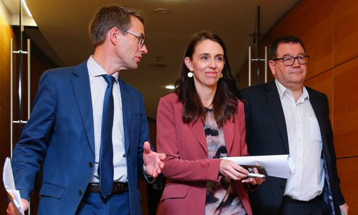 (L–R) Director-General of Health Dr. Ashley Bloomfield, Prime Minister Jacinda Ardern, and Minister of Finance Grant Robertson arrive at a press conference at Parliament in Wellington, New Zealand, on Aug. 17, 2021. (Hagen Hopkins/Getty Images)