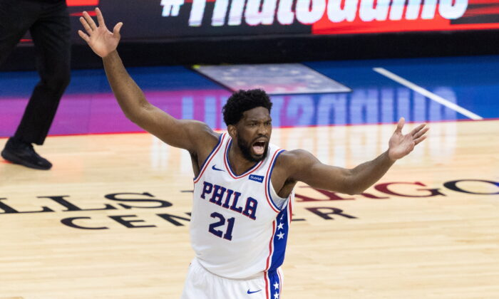 Philadelphia 76ers center Joel Embiid (21) reacts after scoring against the Atlanta Hawks during the first quarter of game seven of the second round of the 2021 NBA Playoffs at Wells Fargo Center in Philadelphia, Pa., on June 20, 2021. (Bill Streicher/USA TODAY Sports via Reuters)