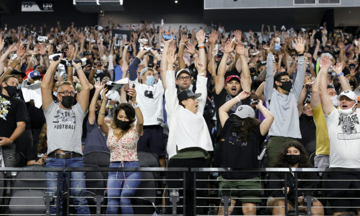 Fans do the wave during a preseason game between the Seattle Seahawks and the Las Vegas Raiders at Allegiant Stadium on Aug. 14, 2021 in Las Vegas, Nevada. (Ethan Miller/Getty Images)