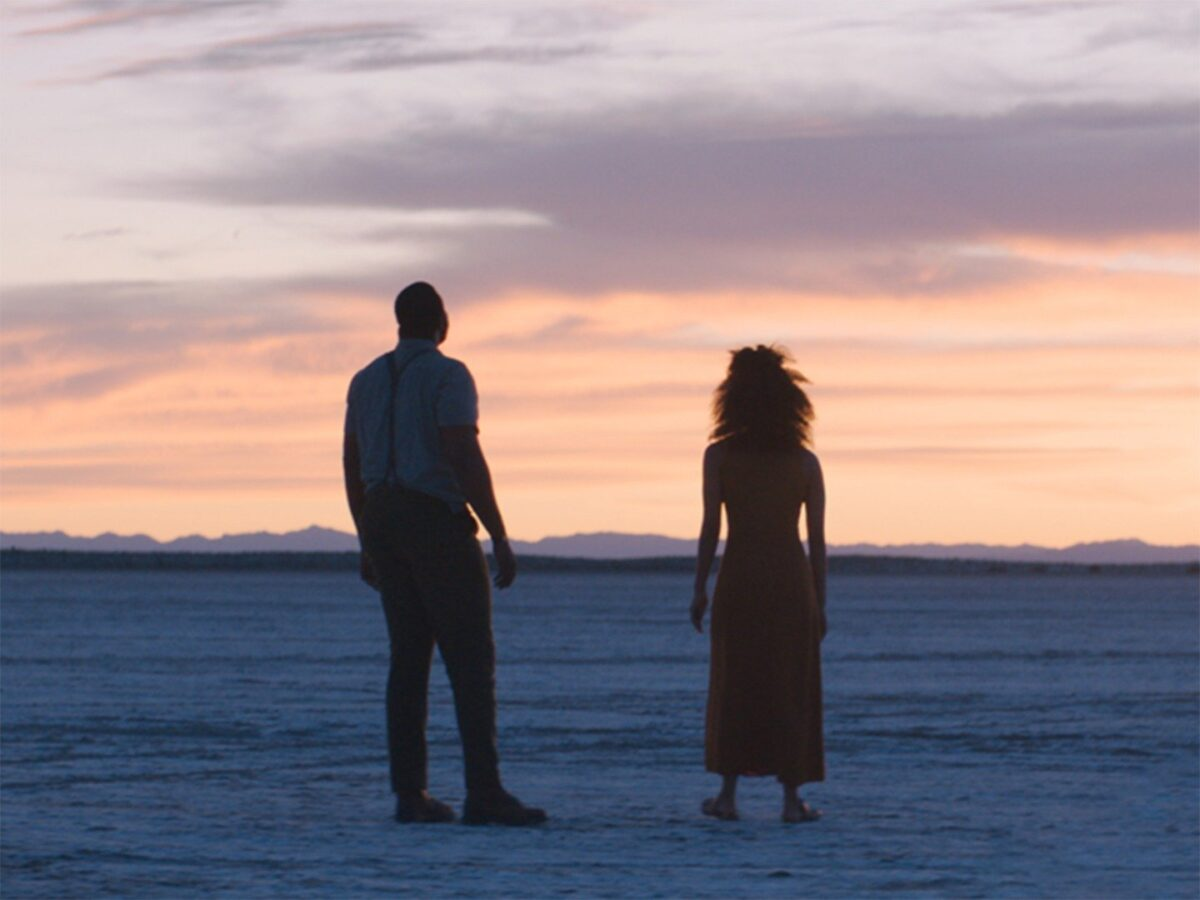 man and woman in the desert in NINE DAYS