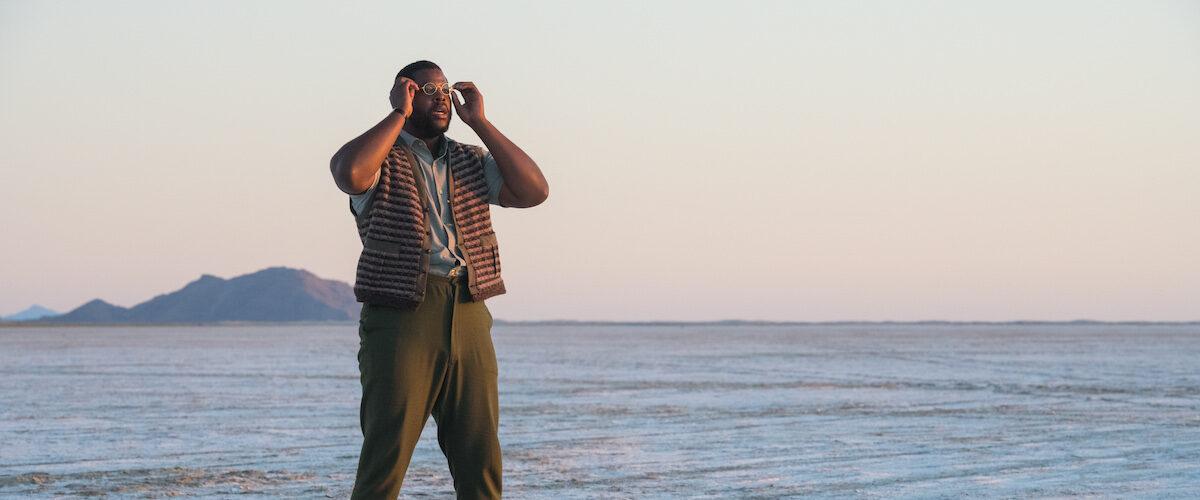 man standing in the desert in NINE DAYS
