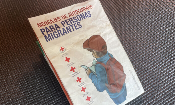 """A Spanish-language pamphlet published by the Red Cross titled """"Messages of Self-Help for Migrants"""" was being carried by an illegal immigrant in Uvalde, Texas. (Charlotte Cuthbertson/The Epoch Times)"""