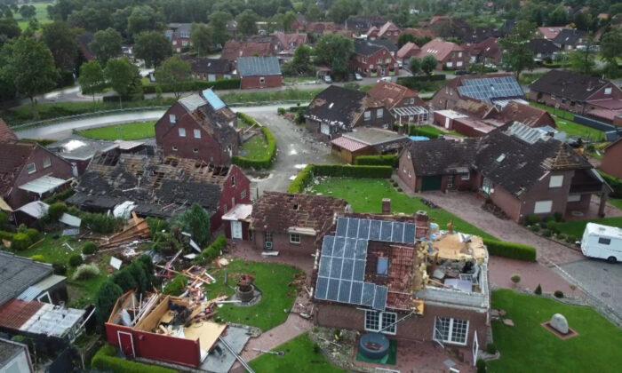 Several houses are damaged by a storm in the village Berumerfehn, Germany, on Aug. 17, 2021. (Joern Hueneke/TNN/dpa via AP)