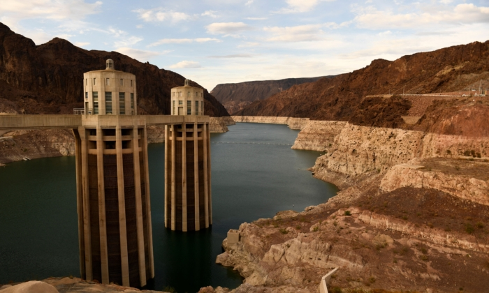 Intake towers for water to enter to generate electricity and provide hydroelectric power stand during low water levels due the western drought on July 19, 2021 at the Hoover Dam on the Colorado River at the Nevada and Arizona state border. (Patrick T. Fallon/AFP via Getty Images)