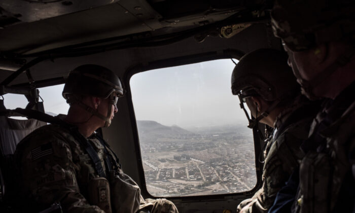 American service members deployed for Mission Resolute Support ride in a helicopter over Kabul on the way to Bagram Air Field in Kabul, Afghanistan, on Sept. 5, 2017. (Andrew Renneisen/Getty Images)