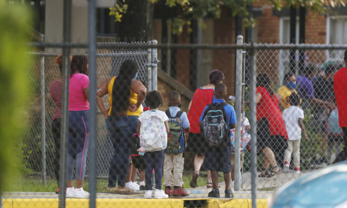 Students return to school at Seminole Heights Elementary School after the Florida Department of Education mandated that all schools must have in-class learning during the week in Tampa, Florida, on Aug. 31, 2020. (Octavio Jones/Getty Images)