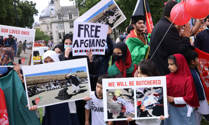 Protesters gather on Parliament Square to protest against the Taliban take over of Afghanistan in London, UK, on Aug. 18, 2021. (Dan Kitwood/Getty Images)