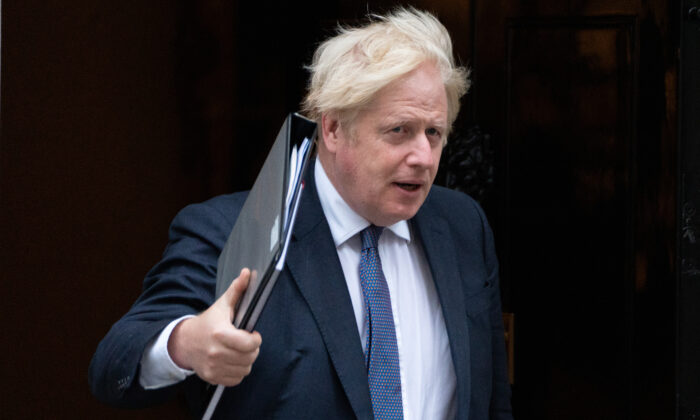 Prime Minister Boris Johnson leaves 10 Downing Street in London on Aug. 18, 2021. (Stefan Rousseau/PA)