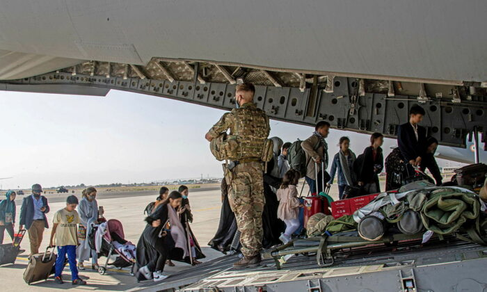British citizens and dual nationals residing in Afghanistan board a military plane for evacuation from Kabul airport, Afghanistan, on Aug. 16, 2021.  (LPhot Ben Shread/UK MOD Crown copyright 2021/Handout via Reuters)